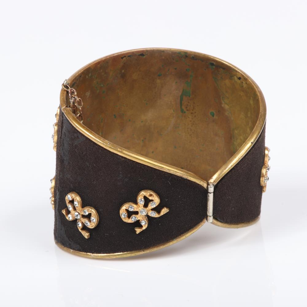 """Henry al a Pensee Depose Paris vintage couture hinged brass cuff bracelet wiht black moleskin ground and nine gold tone tied ribbons with studded rhinestones. 2 1/4""""inner width, 2""""W"""