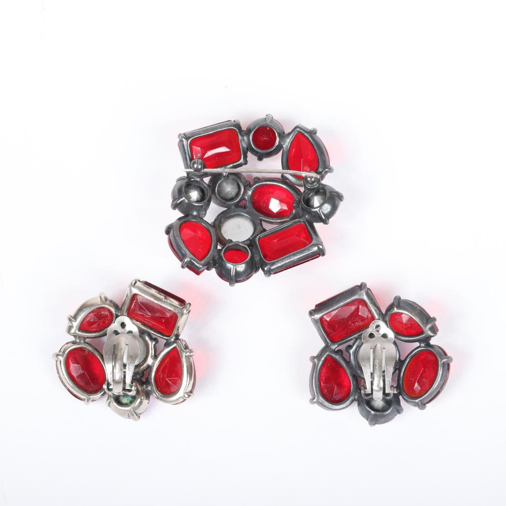 "Schiaparelli RED jewel 2pc. brooch and earrings set with AB rivoli jewels, ruby glass cabochons and faceted crystals. 2""H x 2""W (brooch)"