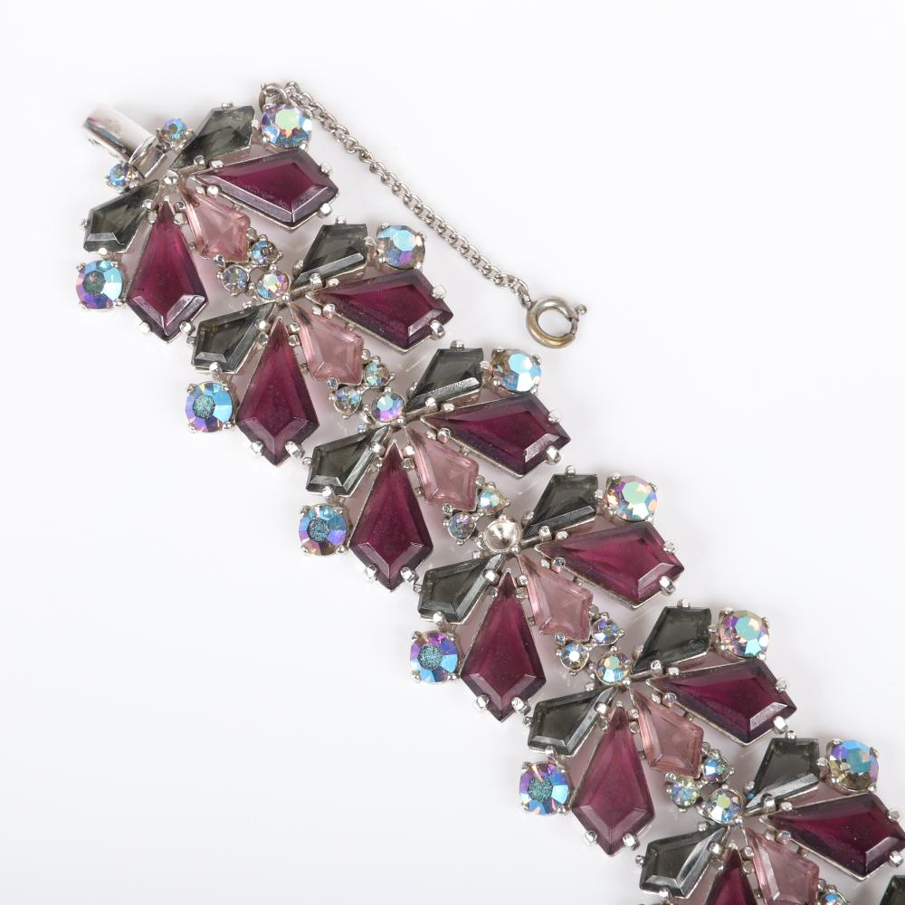 "Schiaparelli bracelet and earring set with large purple diamond shaped crystal jewels, pink and smoke accents and aurora borealis rhinestones. 7 1/2""L x 1 1/2""W (bracelet), 1 1/4""H x 1""W (earrings)"