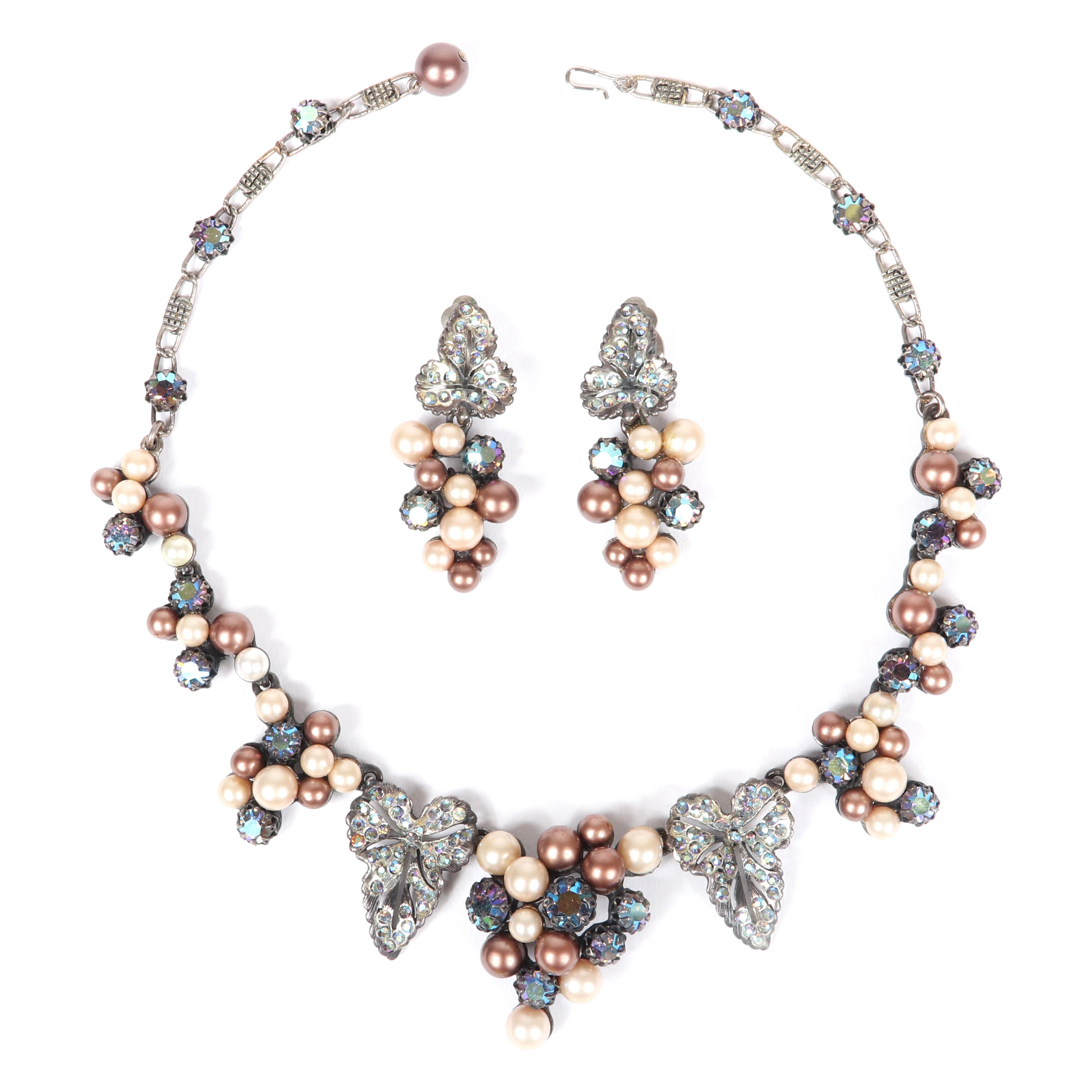 "Schiaparelli 2pc. grape bunch motif demi parure; necklace and earrings with champagne faux pearl and AB rhinestone clusters between openwork silver tone pave leaves. 17""L (necklace)"
