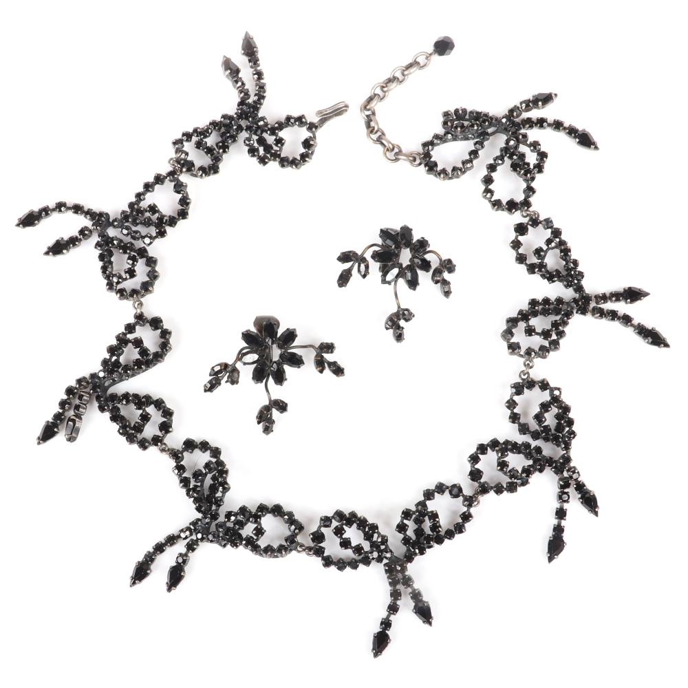 "Vintage unsigned attributed to Christian Dior haute couture designer black jet crystal openwork double bow linked choker necklace with coordinating flower and vine earrings. 16""L x 2""W (necklace), 1 1/2""H x 1 1/2""W..."