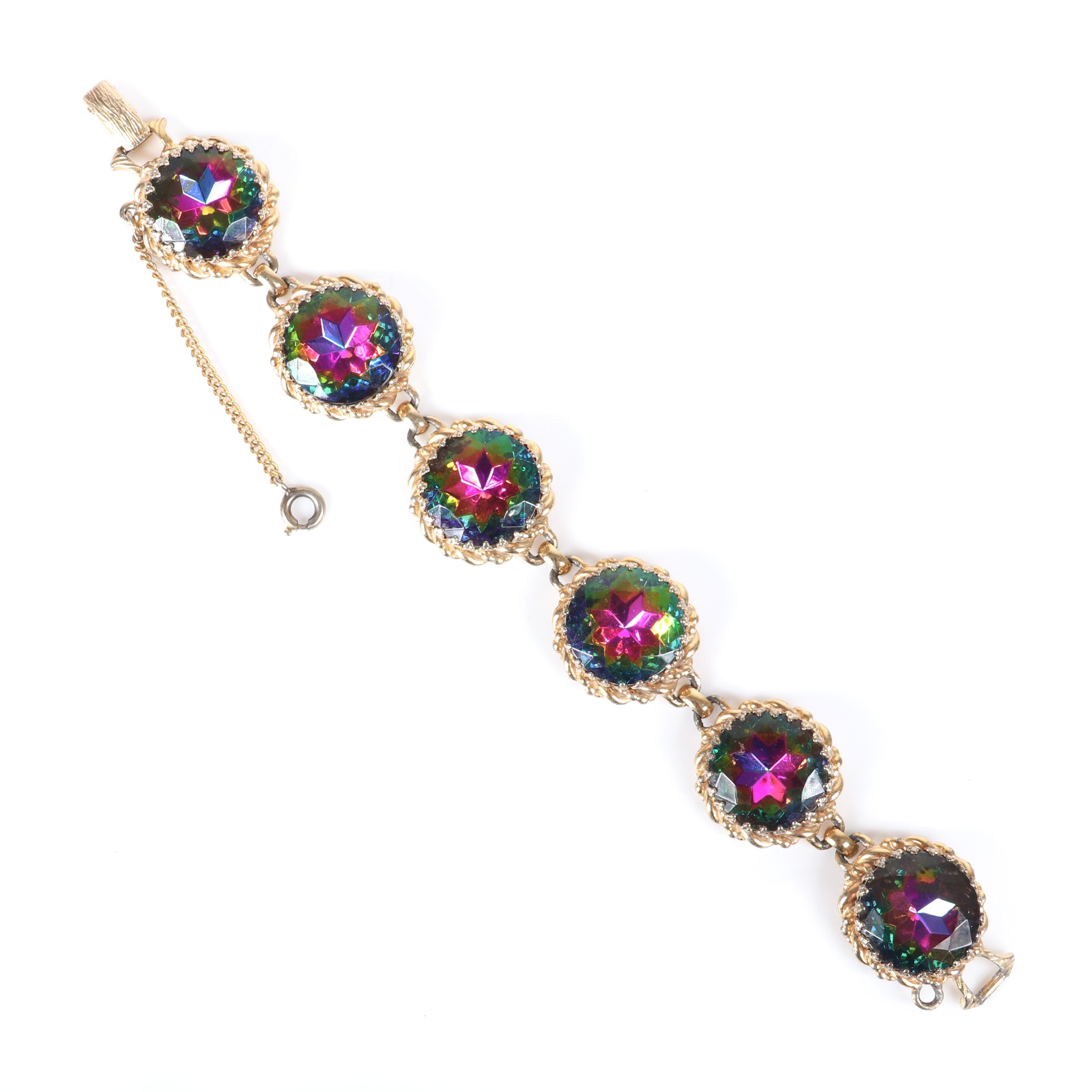 "Schiaparelli gold tone bracelet with six huge linked faceted watermelon AB Rivoli jewels. 7 1/2"", 3/4""W"