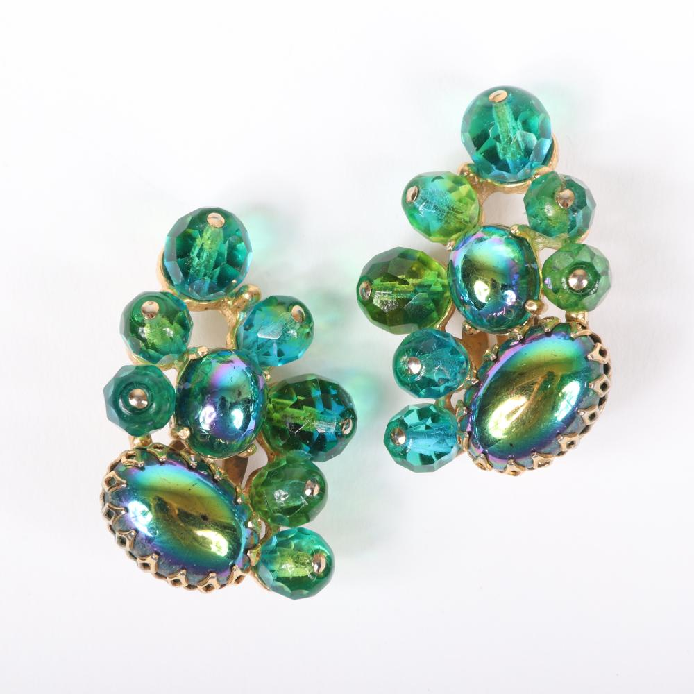"""Schiaparelli 2pc. gold tone green jewel cluster brooch and co-ordinating earrings with unfoiled glass cabochons and molded iridescent leaf stones, faceted crystal bead and oil slick cabochon earrings. 2 3/4""""H x 3""""W..."""