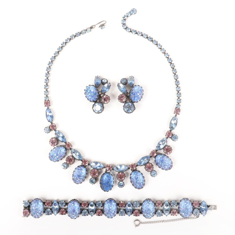 """Schiaparelli vintage designer blue lava glass parure; collar necklace, bracelet, and earrings with iridescent cast glass and faceted pastel blue and pink crystal jewels on matte silver tone metal. 18""""Long (necklace)"""