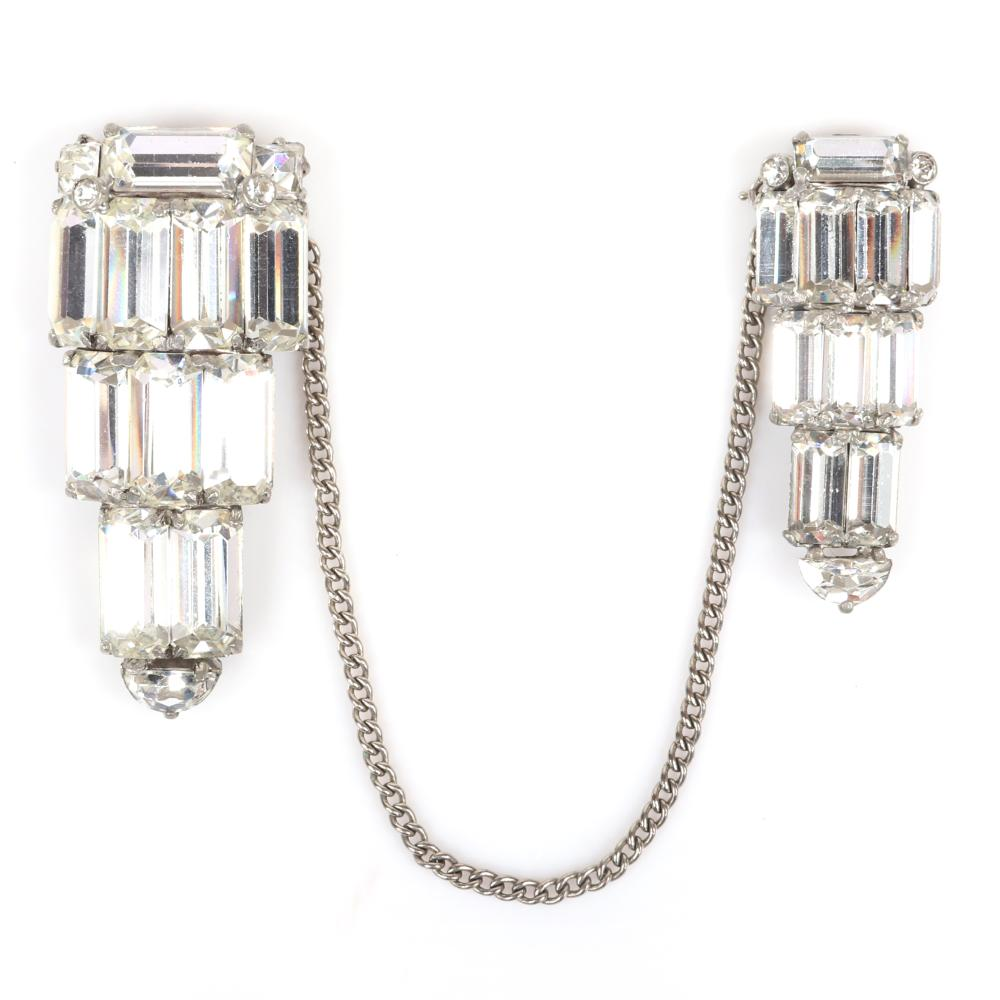 """Eisenberg Original Deco pair of dress clips, one larger and one smaller with three rows of large rhinestone baguettes linked by silver pot metal chain, early 1940s. 2 1/2"""" x 1 1/8"""" (larger), 2"""" x 3/4"""" (smaller)"""