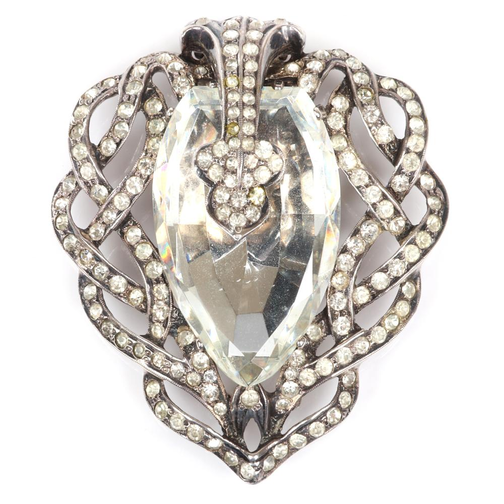 """Eisenberg Original stunning fur clip with woven lines of pave looping around a huge faceted crystal stone, mid-1940s. 2 5/8 x 2"""" 1/4"""""""