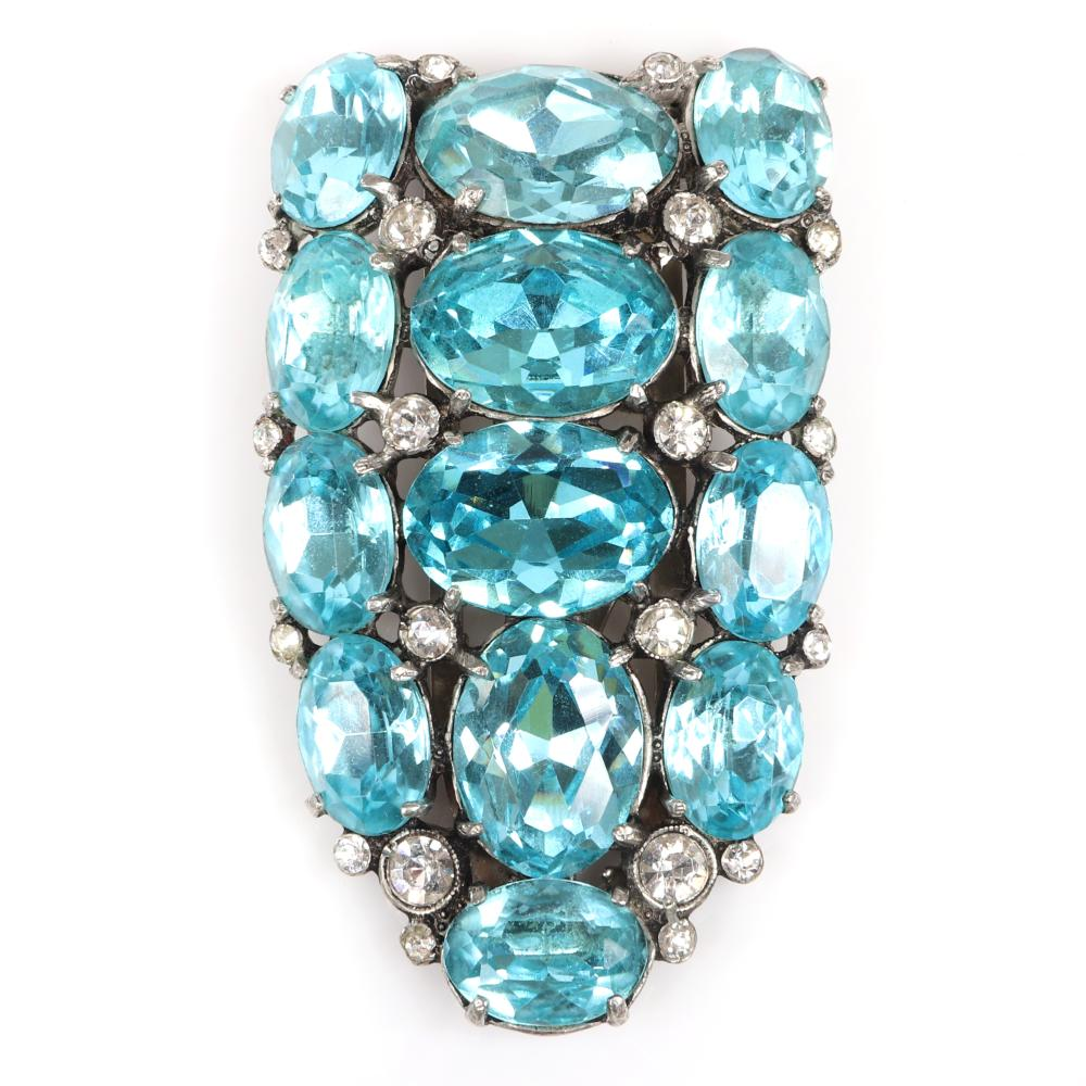 """Eisenberg Original shield dress clip with three rows of of large oval aqua faceted crystals and bezel-set rhinestones, late 1930s. 2 1/4"""" x 1 3/8"""""""