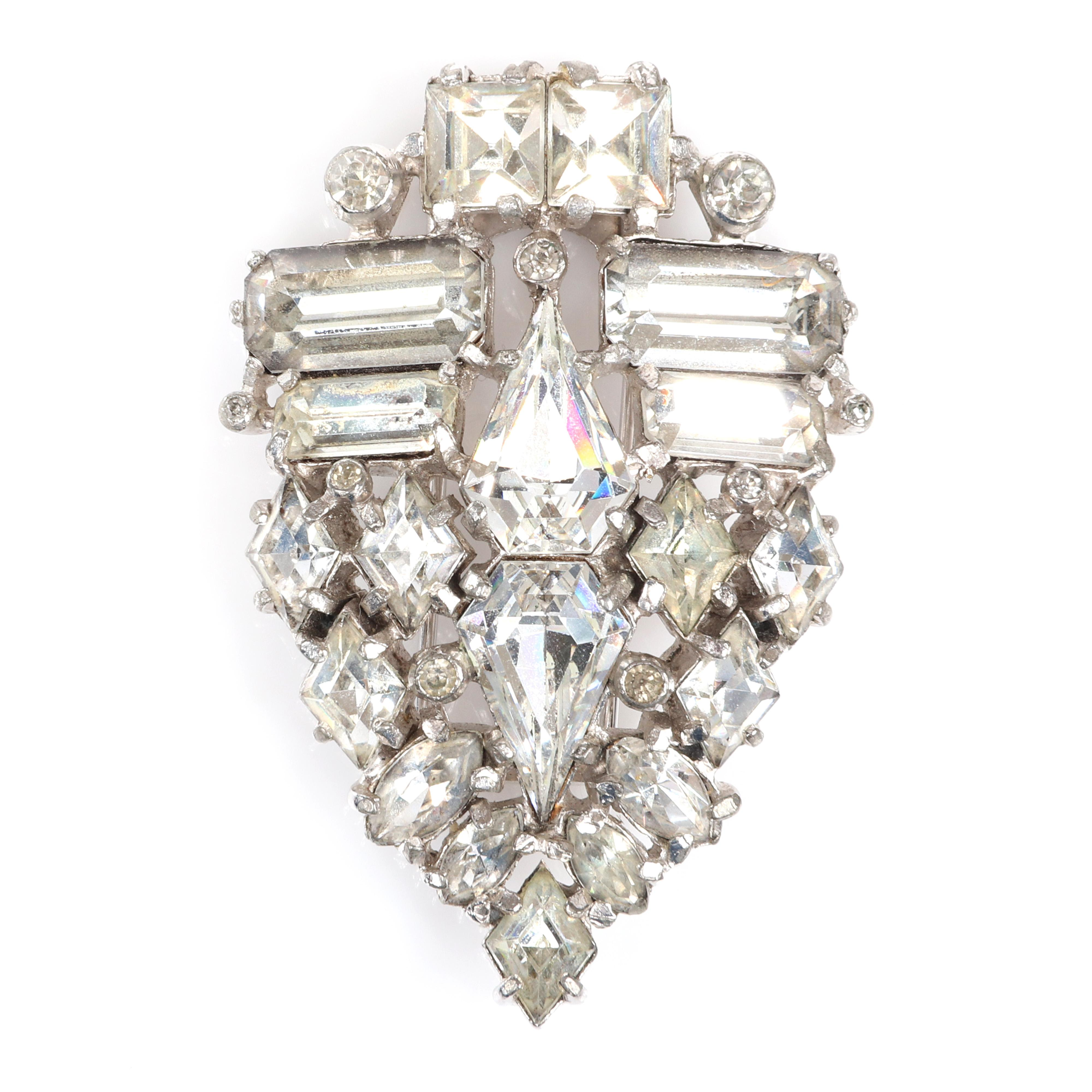 """Eisenberg Original abstract triangular fur clip with silver pot metal and a variety of stone cuts including pear, marquise, round and oval and clear pave sets c. 1940. 3 1/8"""" x 3 3/4"""""""