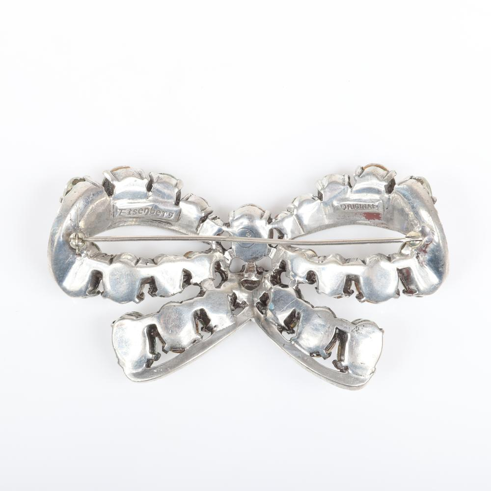 """Eisenberg Original large classic bow brooch with silver pot metal featuring large graduated oval clear crystals and pave, c. 1940. 2"""" x 3 3/4"""""""