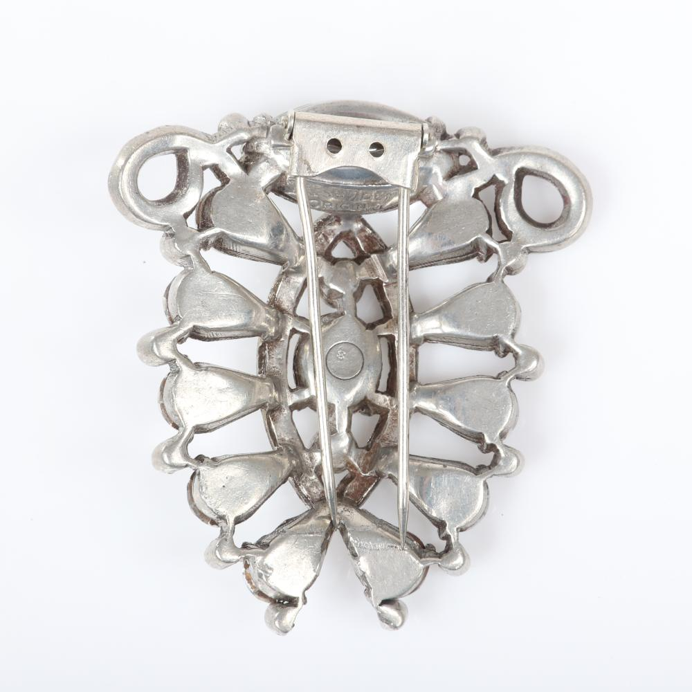 "Eisenberg Original rare open design diamante fur clip with silver pot metal and multiple shapes and cuts of faceted rhinestones capped by a large marquise stone, mid-1940s. 2 3/8"" x 2 1/4"""