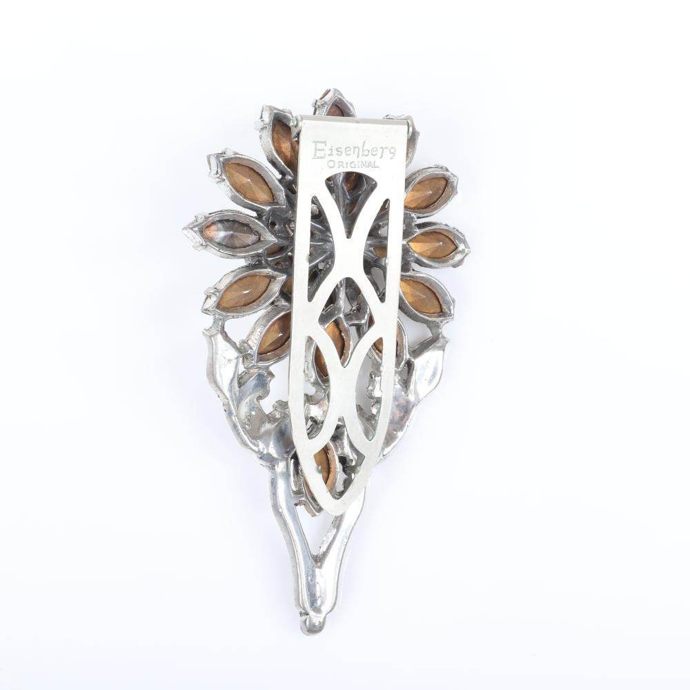 "Eisenberg Original dimensional floral dress clip with silver pot metal, pave and layers of marquise cut crystals surrounding a round central faceted stone, c. 1940. 3 1/2"" x 2"""