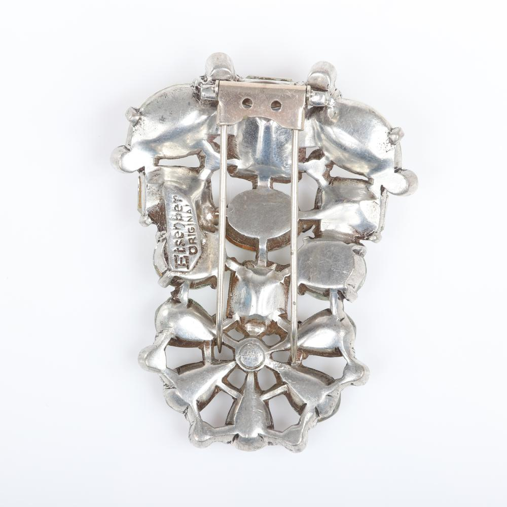 "Eisenberg Original rhinestone fur clip with silver pot metal, large clear crystal stones in various cuts tapering to fan design with bezel-set rhinestones, c. 1940. 3"" x 2"""
