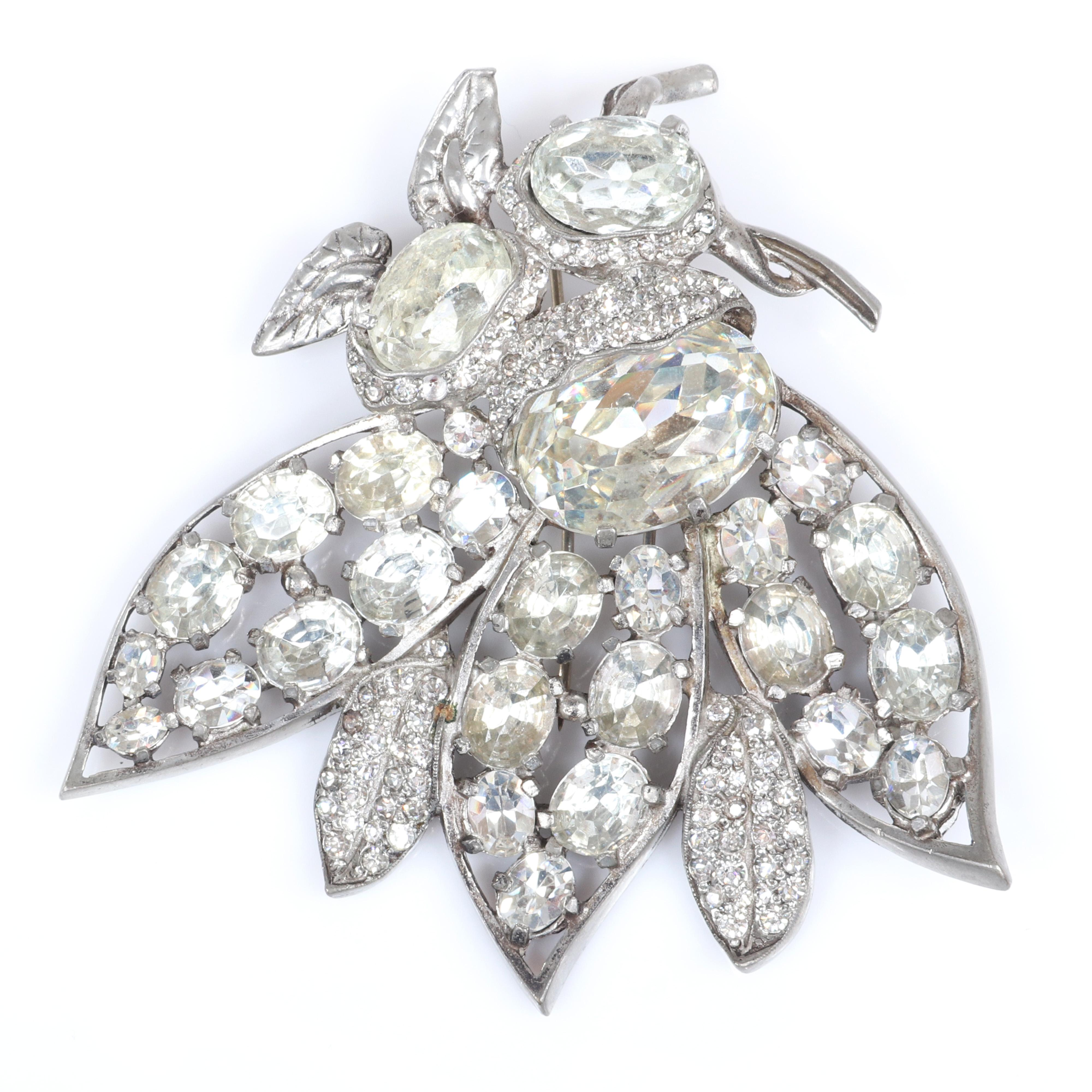 "Eisenberg Original floral diamante fur clip with three large crystals and buds wrapped in pave and decorated with small metalwork leaves, early 1940s. 2 1/4"" x 1 3/4"""
