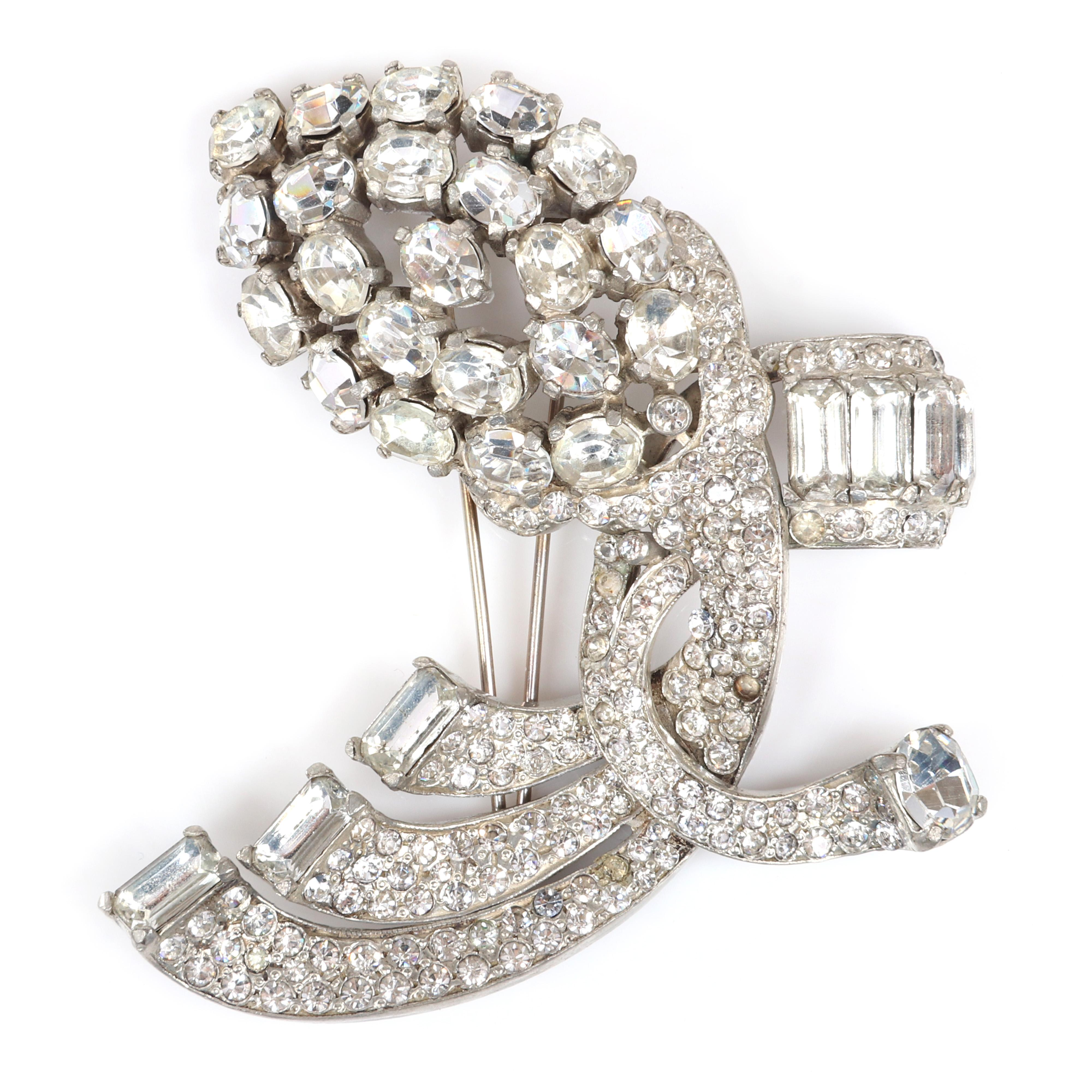"""Eisenberg Original freeform Art Deco diamante stylized floral fur clip with pave and bezel-set rhinestones, baguettes and large faceted crystals, c. 1940. 3 1/2"""" x 3 1/2"""""""