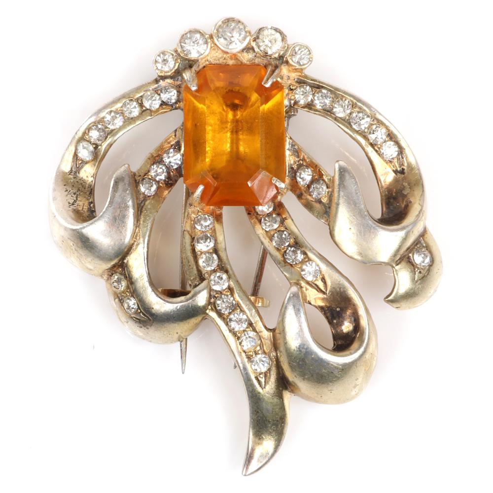 """Eisenberg Original sterling vermeil looping bow fur clip with large central emerald-cut topaz crystal and ribbons lined with rhinestones and bezel-set top stones, mid-1940s. 2 1/4"""" x 2"""""""