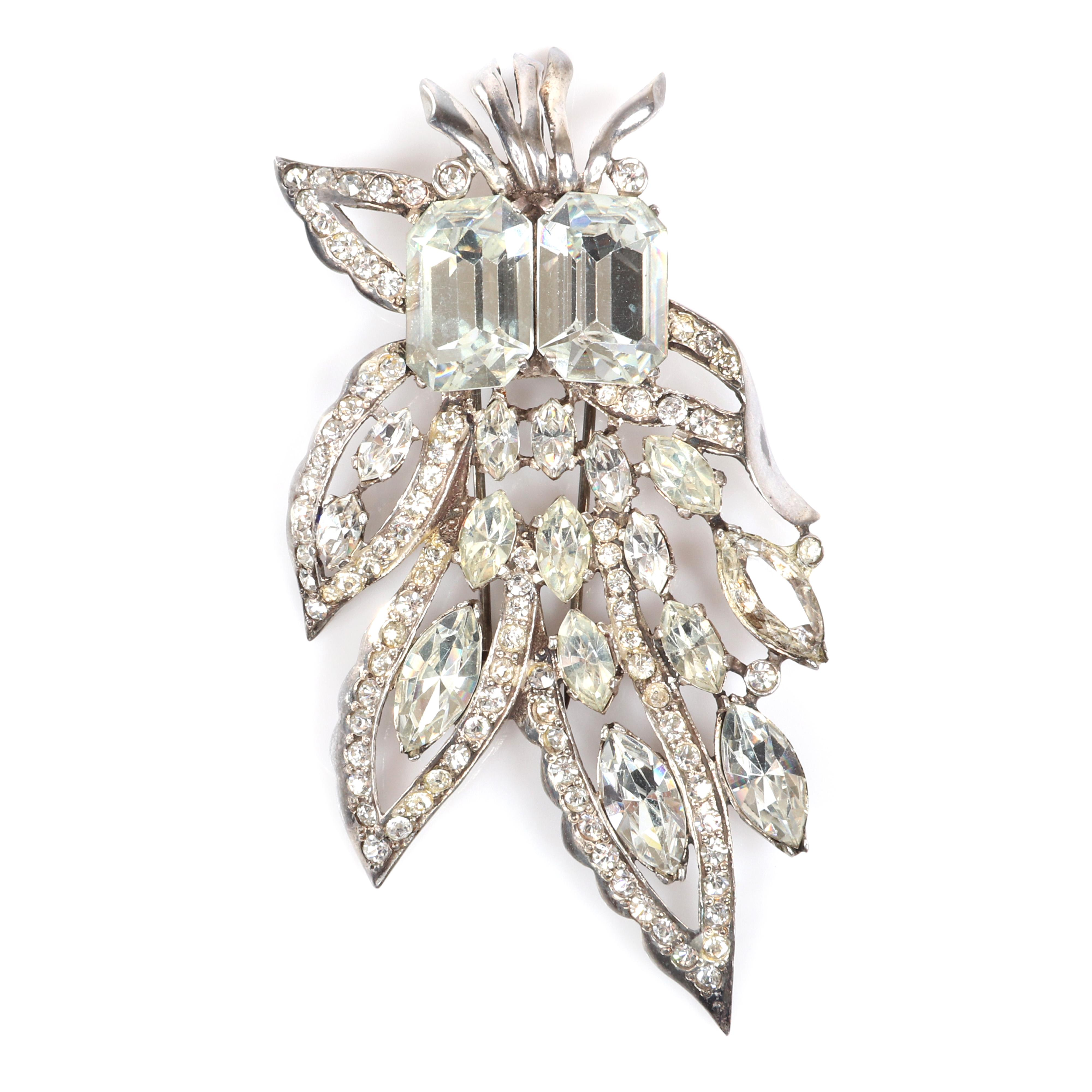"Eisenberg Original large abstract sterling floral fur clip with two large faceted rectangular stones, pave lined leaves and marquise crystals, mid-1940s. 3 3/4"" x 2"""