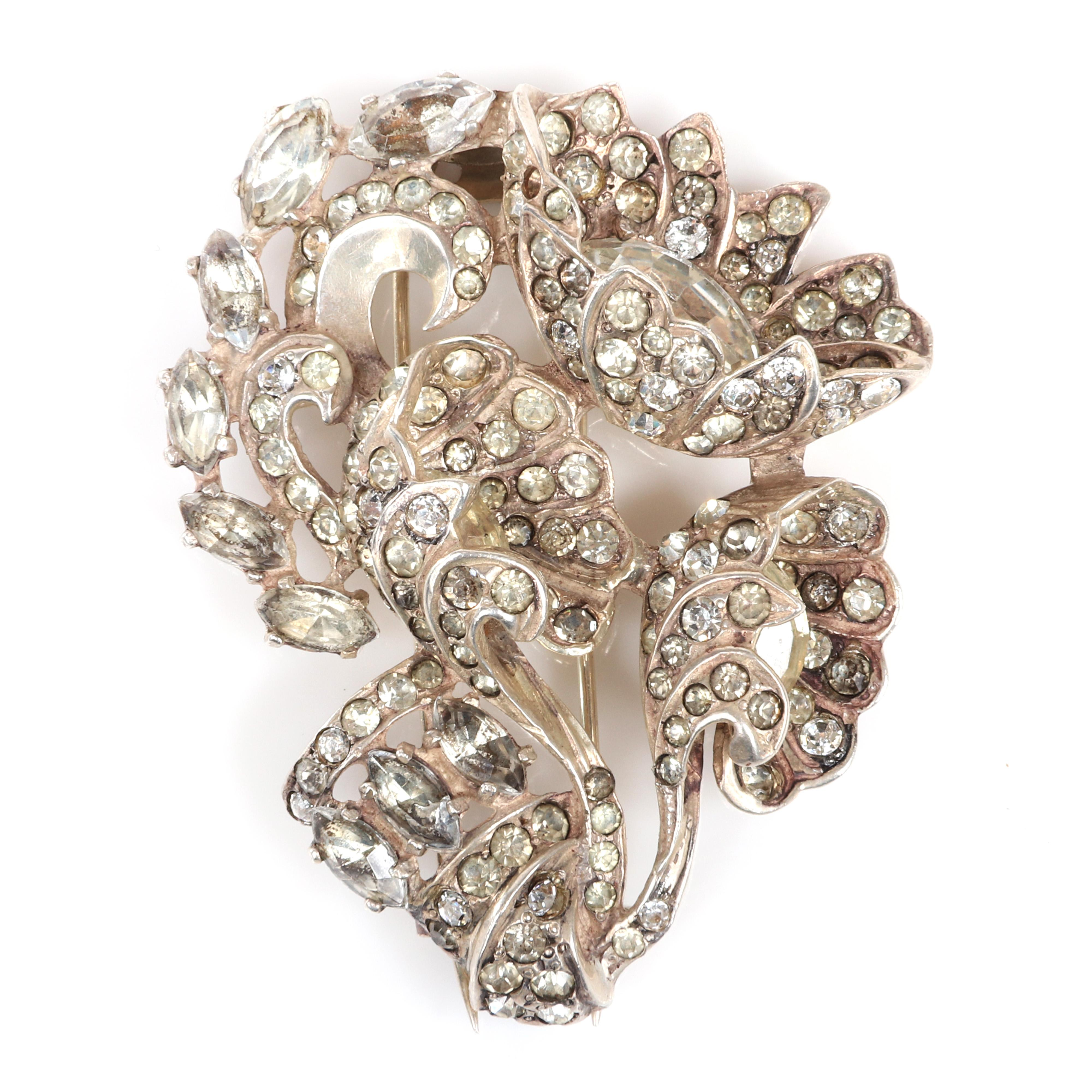 """Eisenberg Original sterling three-dimensional diamante floral fur clip tipped with openwork and pave, tipped with marquise crystals, c. mid-1940s. 2 1/2"""" x 2"""""""