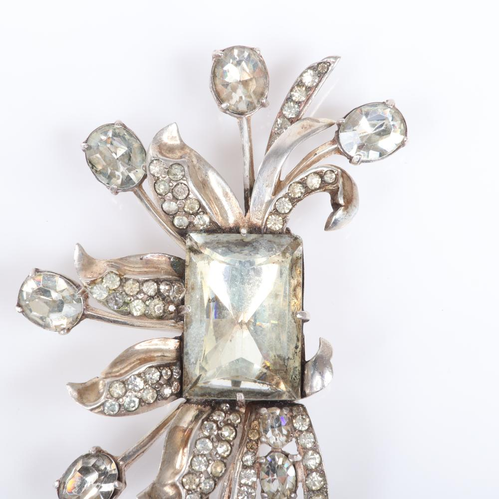 """Eisenberg Original floral fur clip with large rectangular central crystal, a variation on the 1941 King's Ransom piece with silver pot metal, pave leaves and oval stone blooms. 3 7/8"""" x 3 1/2"""""""
