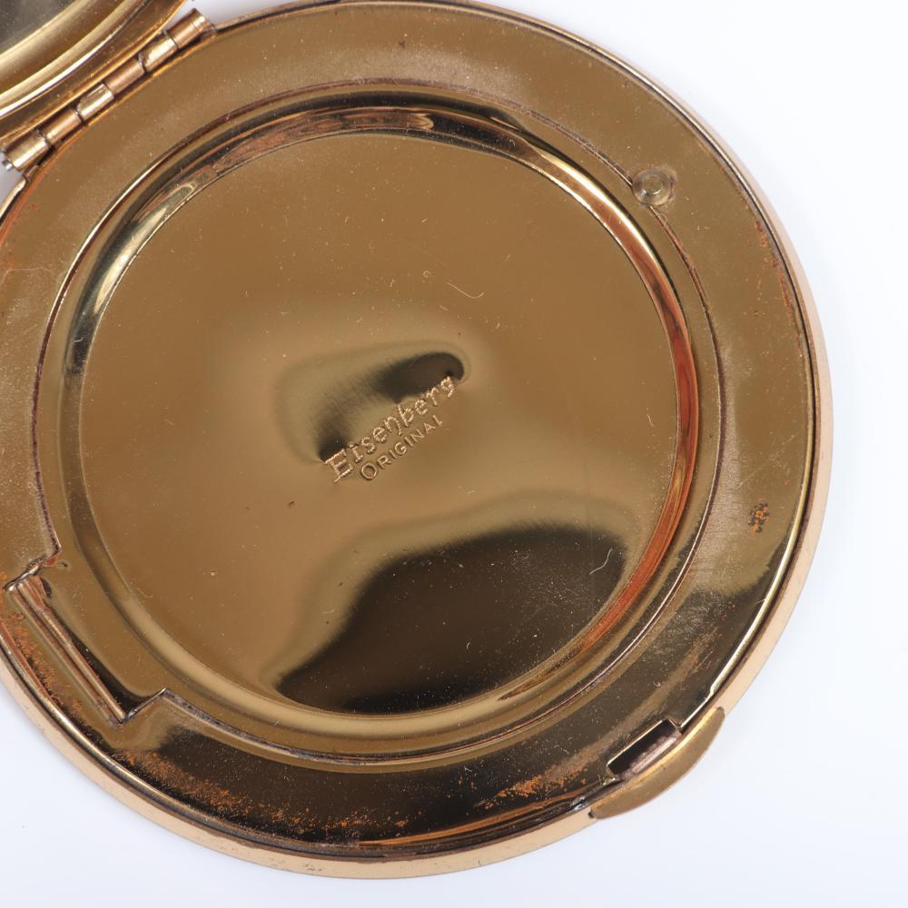 "Eisenberg Original compact exterior beveled-mirror edged in multicolor prong-set jewel-toned prong-set round rhinestones with powder compartment & original box, c. 1940s. 3 1/4""diam."