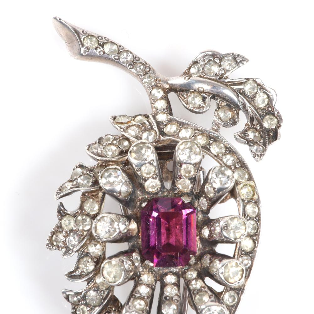 """Eisenberg Original sterling silver floral fur clip with central emerald-cut amethyst crystal, dimensional petals tipped in rhinestones, and pave details, with setter's mark. 2 1/2"""" x 1 1/2"""""""