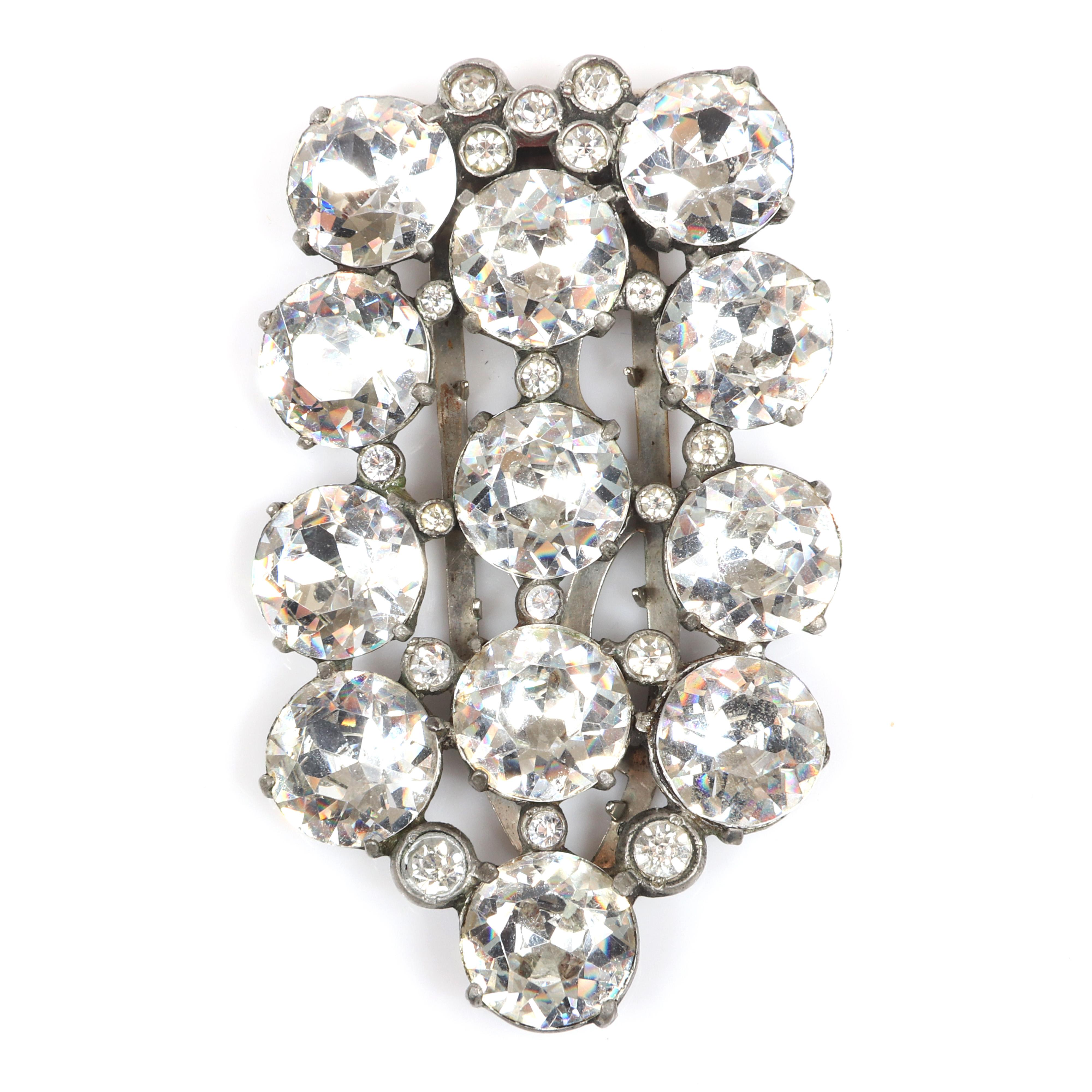 "Eisenberg Originals shield form dress clip with huge round faceted jewel crystals separated by bezel-set rhinestones, c. 1940s. 3"" x 1 1/4"""