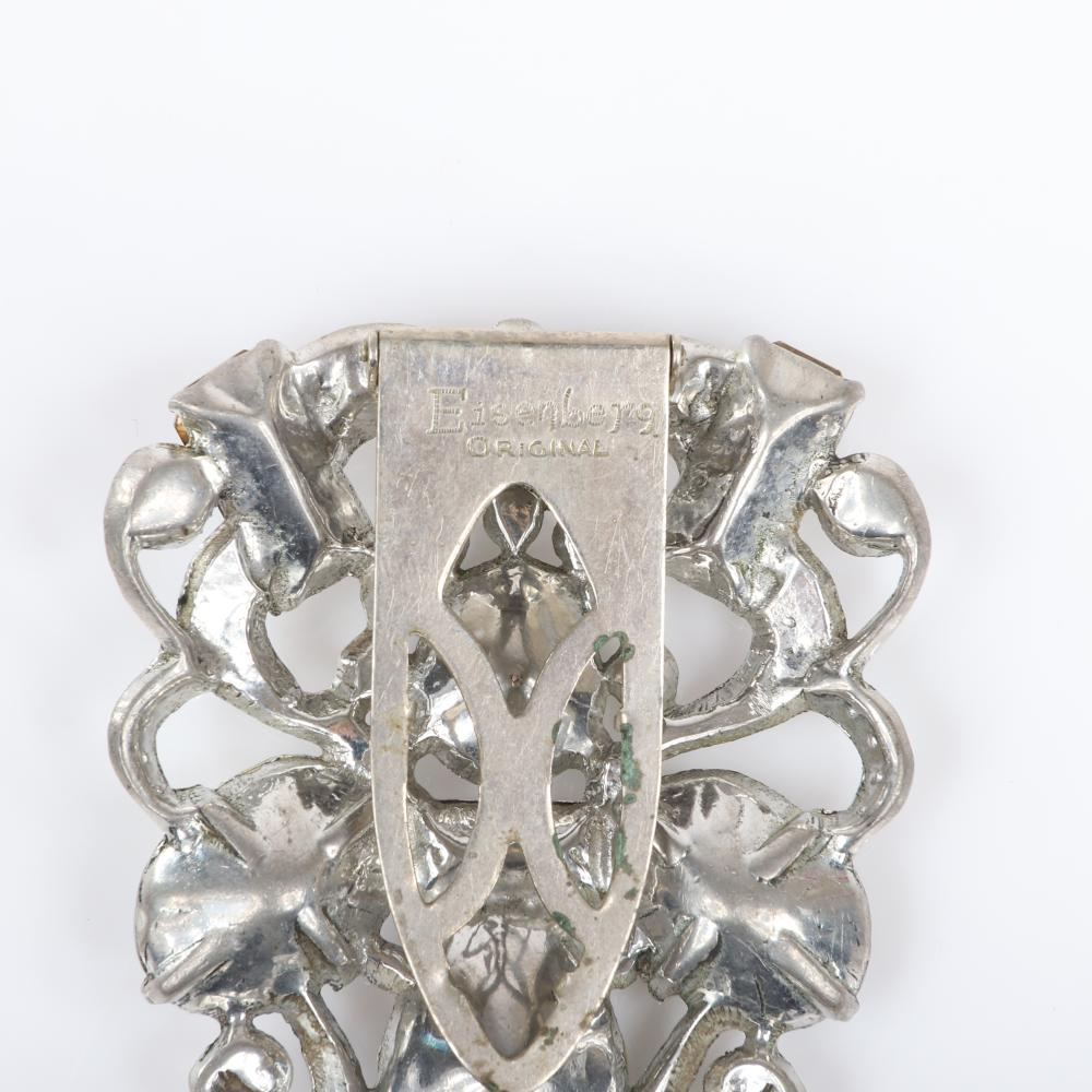 "Eisenberg Original baroque shield form dress clip with large colorless crystal diamante jewels and rhinestones in pot metal, c. 1940s. 2 3/8"" x 2"""
