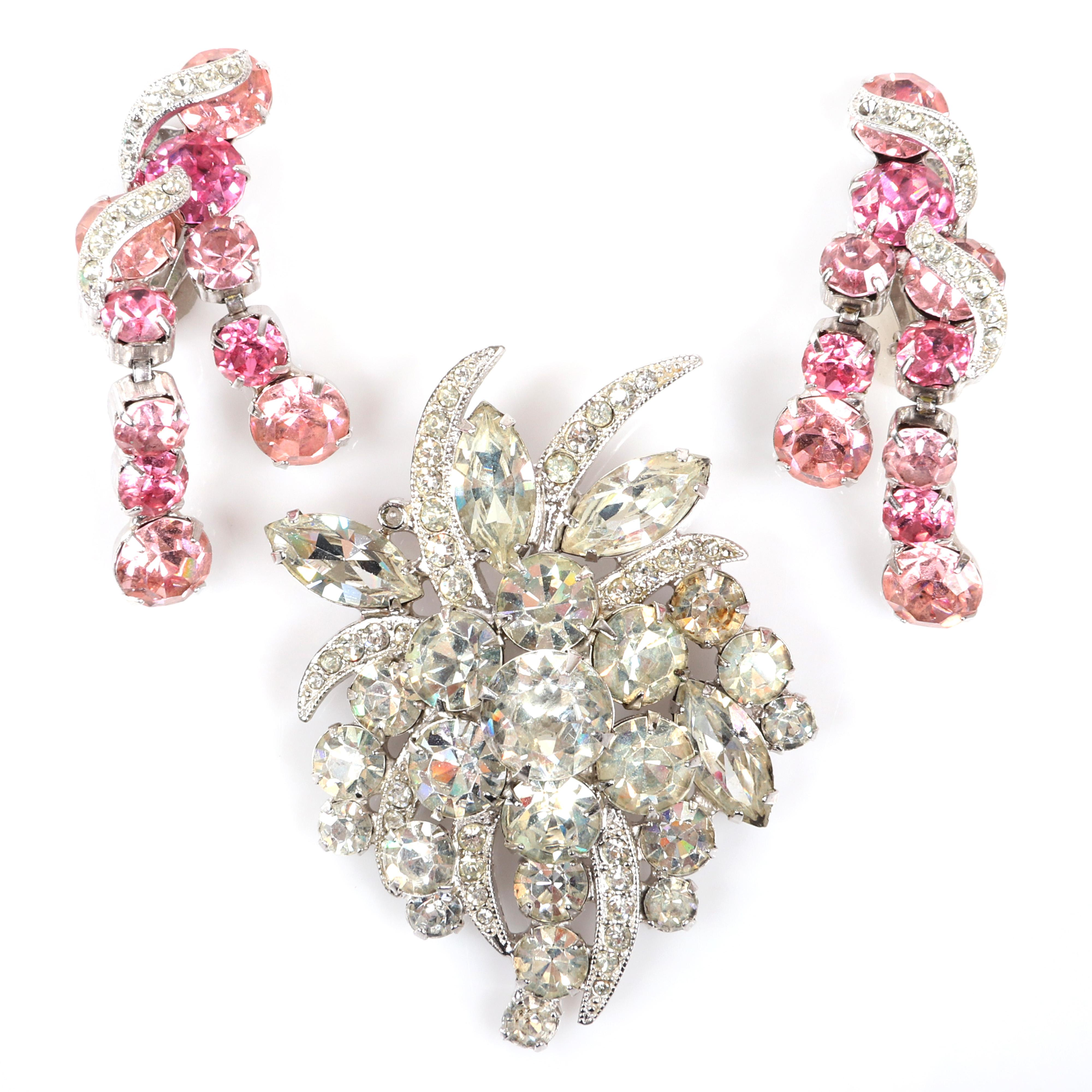 "Eisenberg Ice drop clip rhodium plated earrings with pink rhinestones and pave forming two swinging drops, paired with diamante floral brooch, c. 1950s. 2 1/8"" x 5/8"""