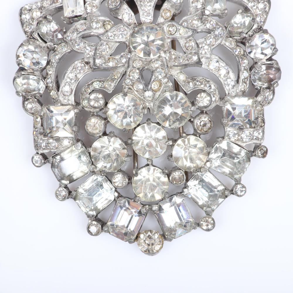 """Eisenberg Original fur clip in silver pot metal with colorless crystal diamante and rhinestones in a floral cartouche design, c. 1940s. 2 3/4"""" x 2 3/4"""""""