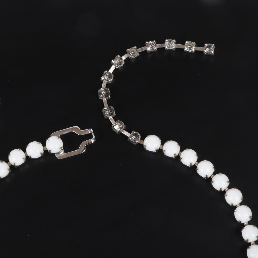 """Eisenberg Ice demi-parure milk glass, pave and pale blue faceted crystal group; necklace graduated and marquise stones and three-row bracelet, c. 1950s. adjustable to 16 1/2"""" (necklace), 7""""L x 2/3""""W (bracelet)"""