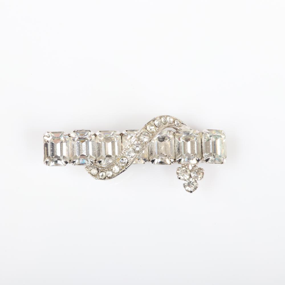 """Eisenberg Ice rare men's tie clip in rhodium with emerald-cut rhinestones and pave with Deco clip earrings with stacked emerald-cut stones, marked Block E, 1950s. 1/4"""" x 1 3/4"""" (tie clip), 1"""" x 3/4"""" (earrings)"""