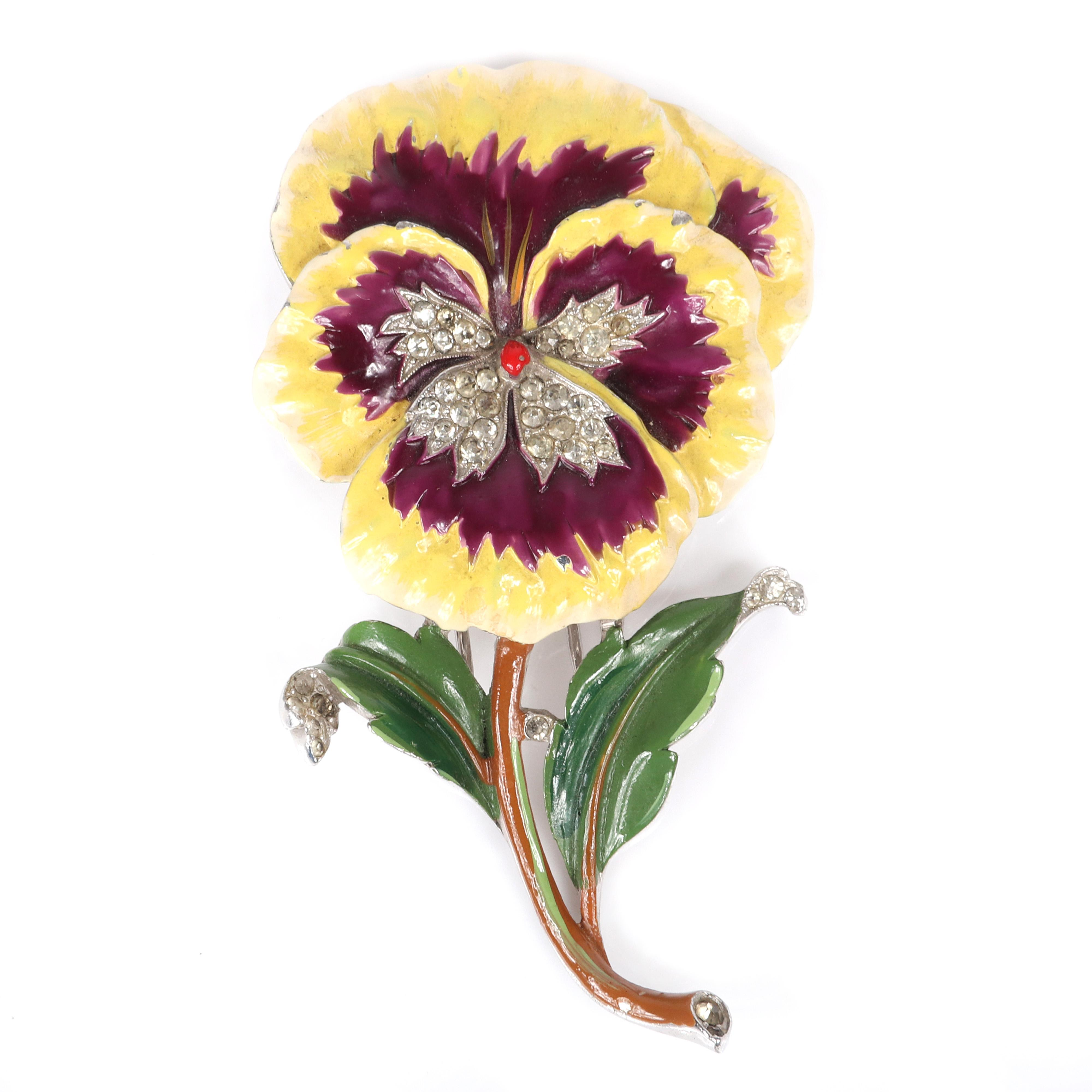 """Trifari 'Alfred Philippe' figural pansy flower pin clip with yellow and purple enamel and pave rhinestones, 1940s. 3 1/8""""H."""