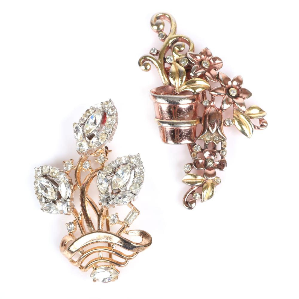 """Two Trifari 'Alfred Philippe' gold tone flower basket pins: green and rose gold tone clip with bezel set rhinestones, and openwork pin with three diamante crystal jewels. 2""""H x 1""""W (clip)"""