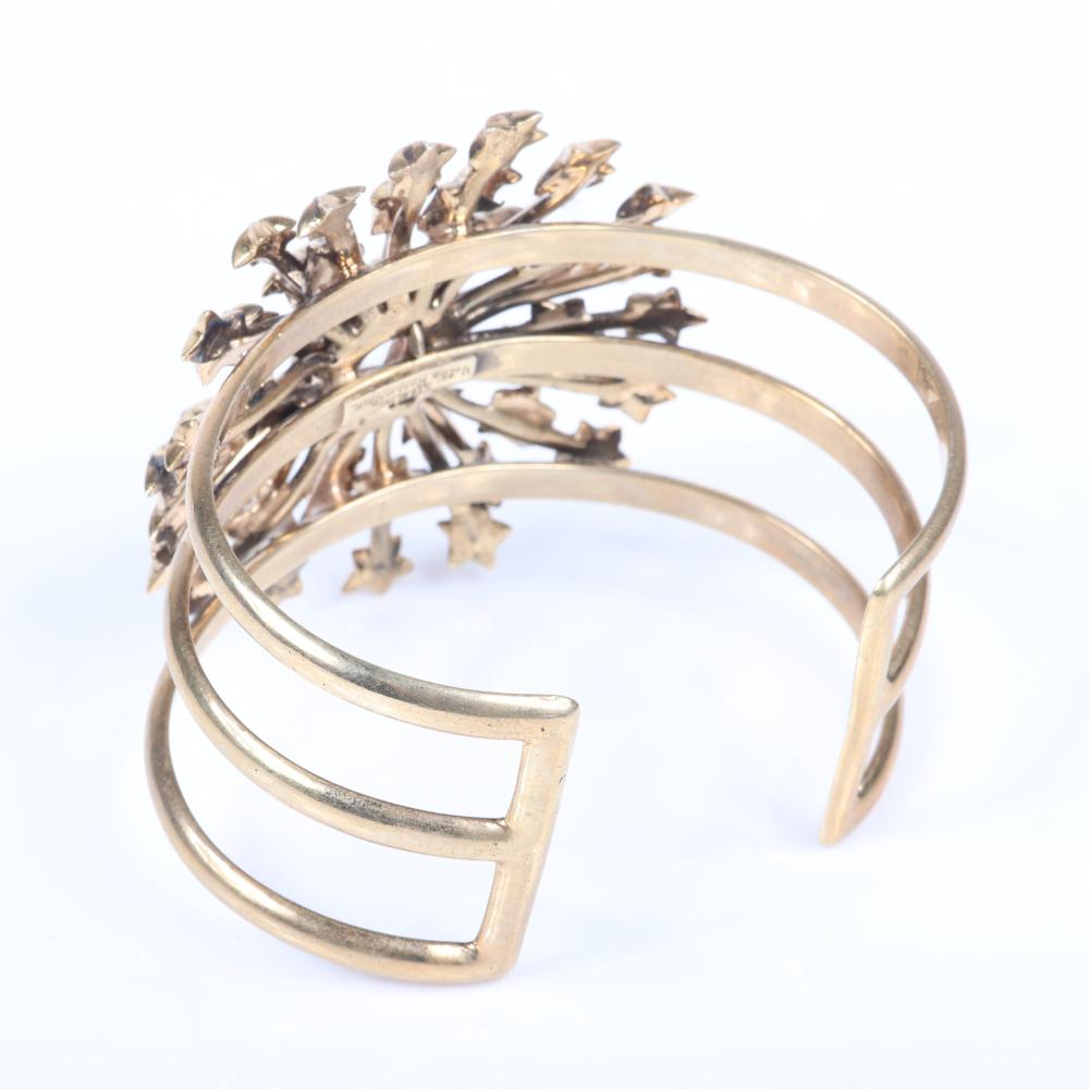 """Nettie Rosenstein sterling and gold vermeil cage cuff bracelet with layered shooting stars starburst capped with diamante rhinestones and large central faceted crystal. 2 3/8"""" inner width, 2 1/4""""diam (starburst)"""