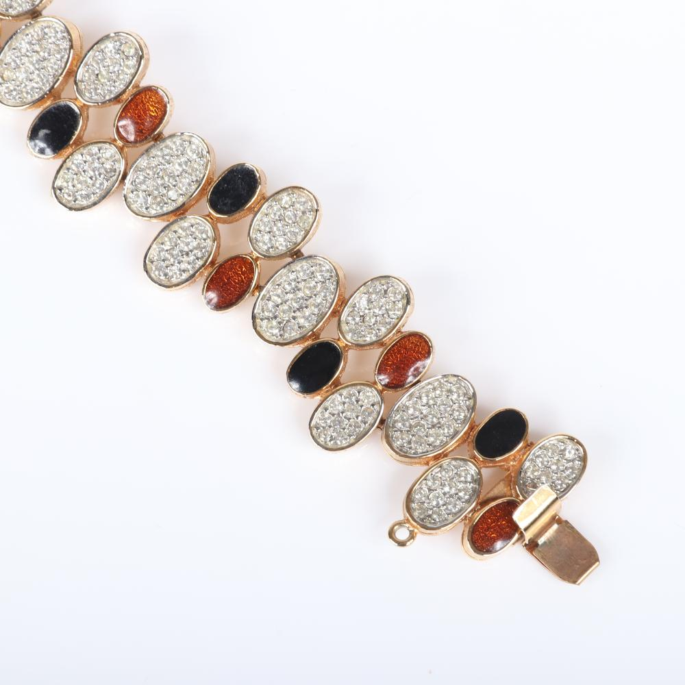 "D'Orlan textured bracelet with ovals of faux clear, black and copper pave, paired with a Nettie Rosenstein enamel and pave figural road runner bird pin. 7""L (bracelet)"