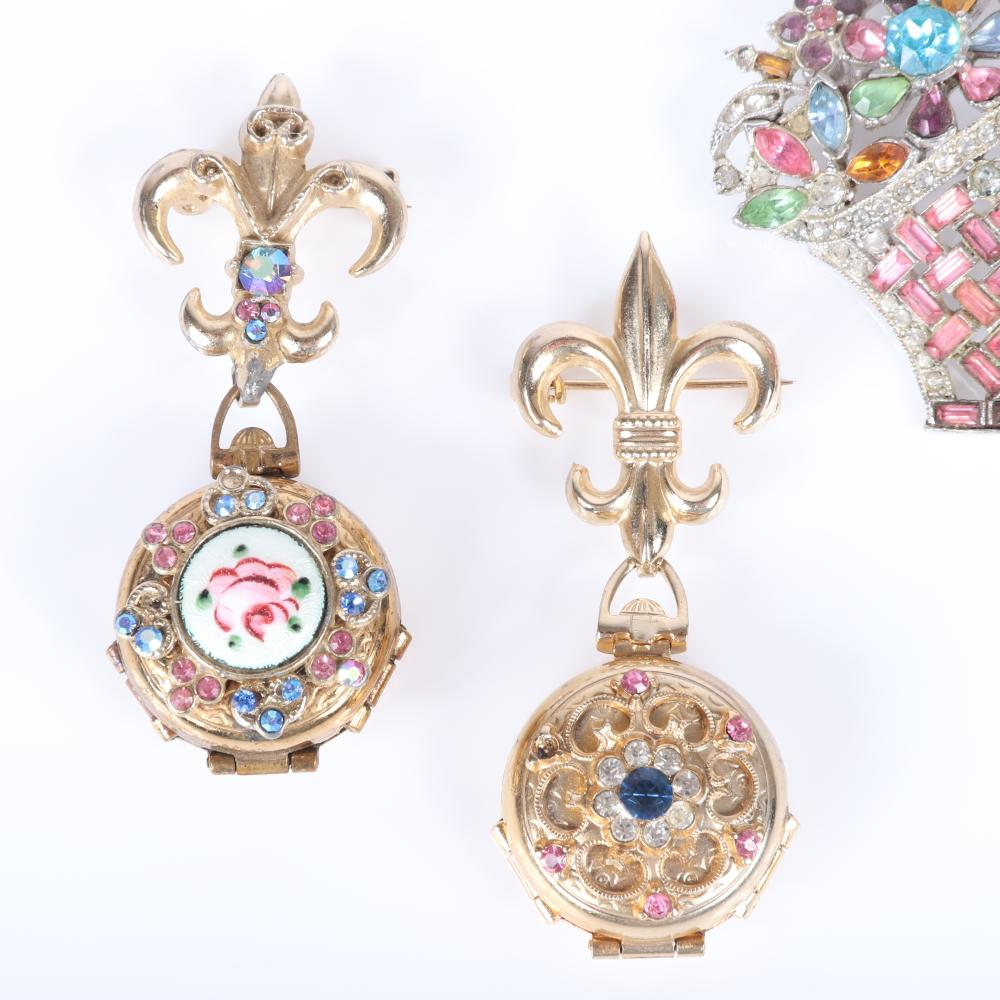 "Coro Craft the 1950s pins: two ""Family Album"" fleur de lis locket pins with pink and blue rhinestones and flower basket brooch with pink baguettes and pastel crystals. 2 1/2""H (each locket)"