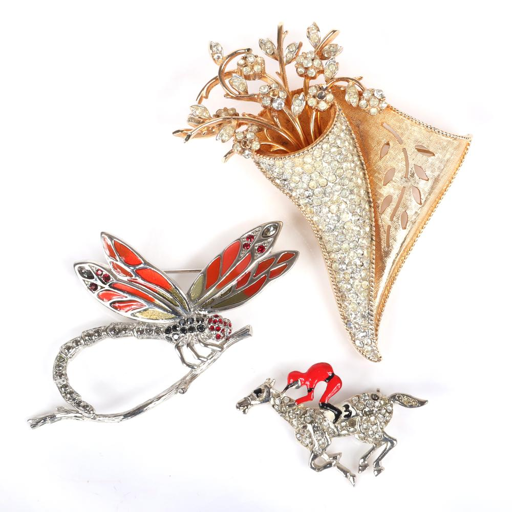 """Three vintage pins: Judith Leiber enamel and pave dragonfly, pave and red enamel racing #3 jockey and Francoise pave cornucopia flower basket. 3""""H x 2 3/4""""W (cornucopia)"""