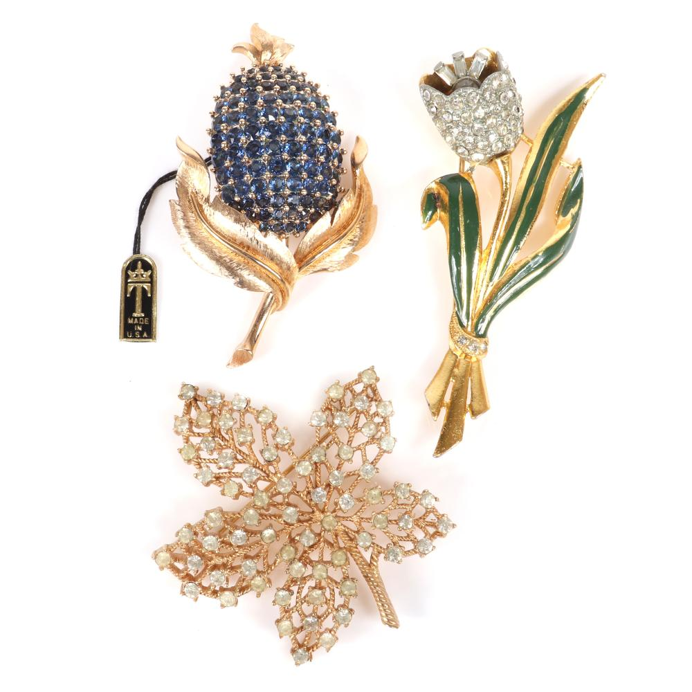 """Three vintage pins: Coro green enamel and pave trembler flower pin, Trifari leaf brooch with rhinestones and Trifari sapphire blue bead set crystal flower fruit pin with original foil tag. 3 1/4""""H (coro tulip)"""