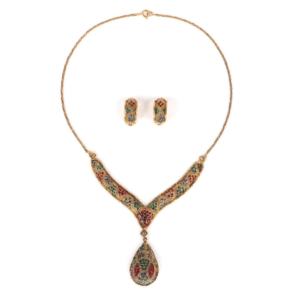 """Bergere Moghul style gold tone textured V and pendant necklace with drop teardrop pendant and hoop earrings studded with tri-color ruby, sapphire and emerald rhinestones. 18""""L, 2 3/4""""drop"""