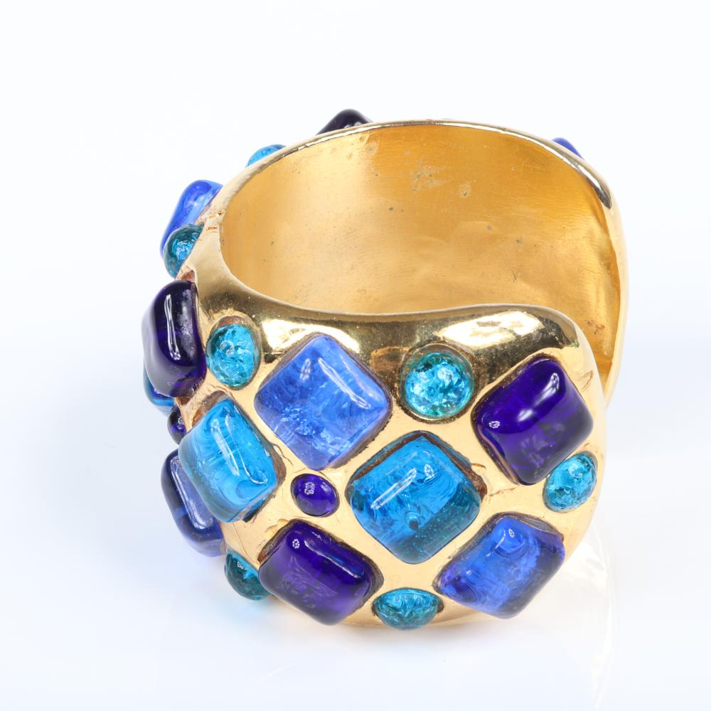 "Dominique Aurientis Paris French Designer wide gold tone cuff bracelet with dimensional round and square art glass jewels in shades of blues. 2"" (inner width), 2"" (bracelet width)"