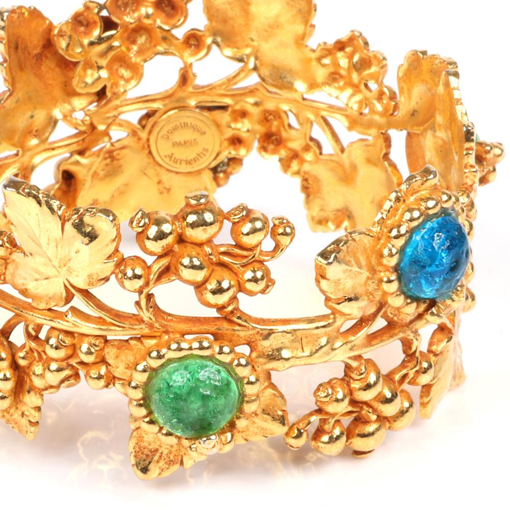 "Dominique Aurientis Paris couture designer gold tone vining fruit bangle bracelet with six blue and green textured glass cabochons. 2 1/2"" inner width, 1 3/4""W"