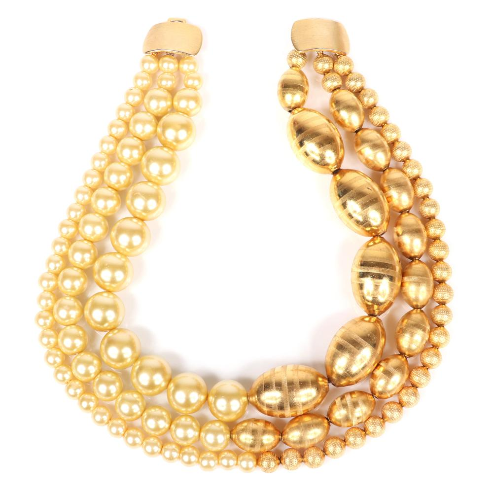 """Jay Feinberg (Strongwater) triple strand necklace with graduated strands of faux pearls and gold tone large spiral and smaller round textured beads. 16""""L"""