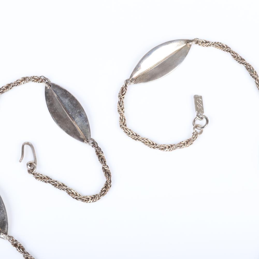 """Yves Saint Laurent YSL designer couture silver tone twisted chain and stylized leaf motif necklace with large black crystal pendant with two round silver rhinestone dangles. 34""""L, 3 3/4""""L (pendant)"""