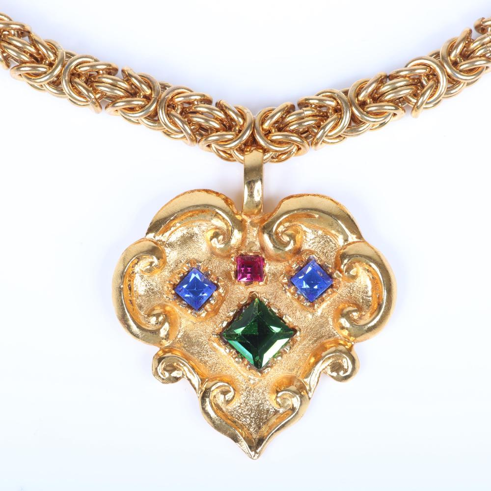 """Christian Lacroix Designer Couture gold tone chunky chain necklace with textured stylized heart cartouche pendant with four raised faceted square jewel-tone crystals. 23""""L, 2""""H x 2""""W (pendant)"""