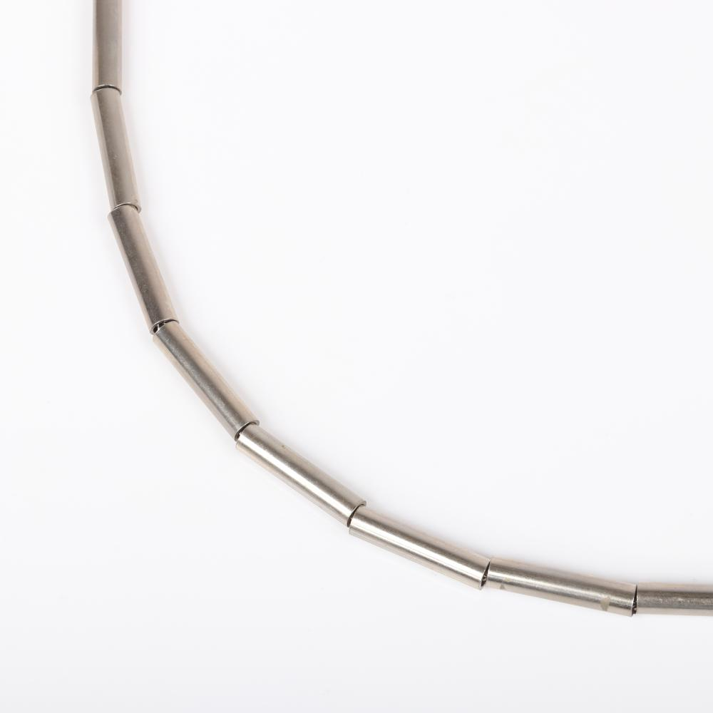 "Two Yves Saint Laurent YSL silver tone snake chain necklaces: one with 23 sliding tubular beads and 3-strand with four tubular bead stations. 34""L (longest)"