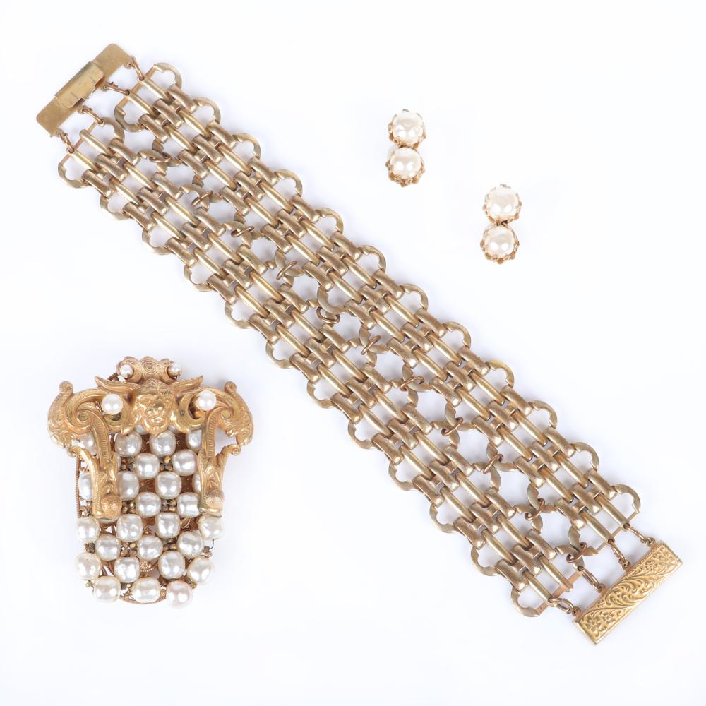 """Miriam Haskell 3pc: faux pearl brooch with brass figural gargoyle, wide brass woven chain bracelet and faux pearl earrings. 7 1/2""""L x 1 3/4""""W (bracelet), 2 1/2""""L (bracelet)"""