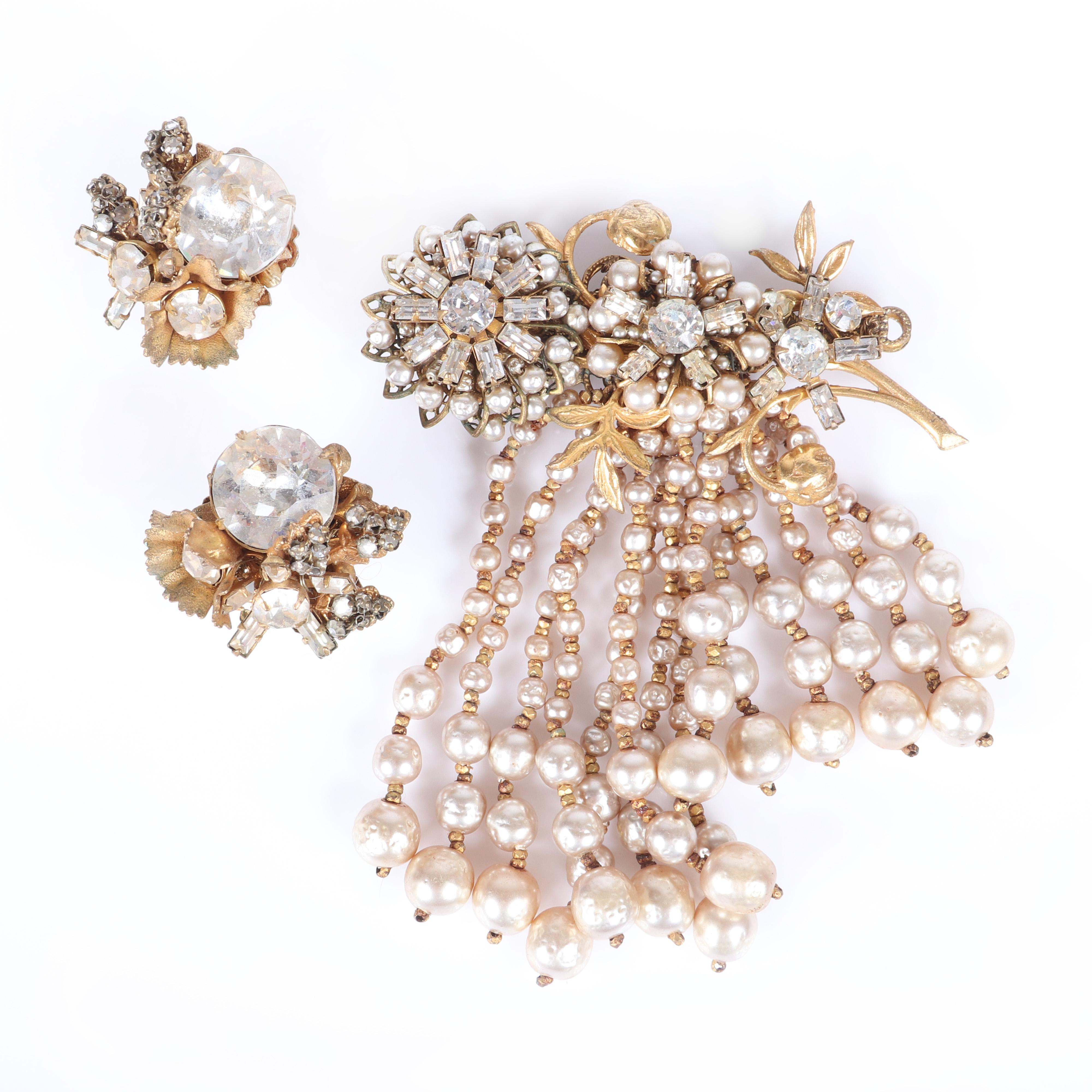 """Miriam Haskell flower spray brooch with rhinestones, baguettes and 14 cascading graduated pearl dangles, with coordinating earrings with huge central rhinestones. 3""""W, 3 1/2""""drop (brooch)"""