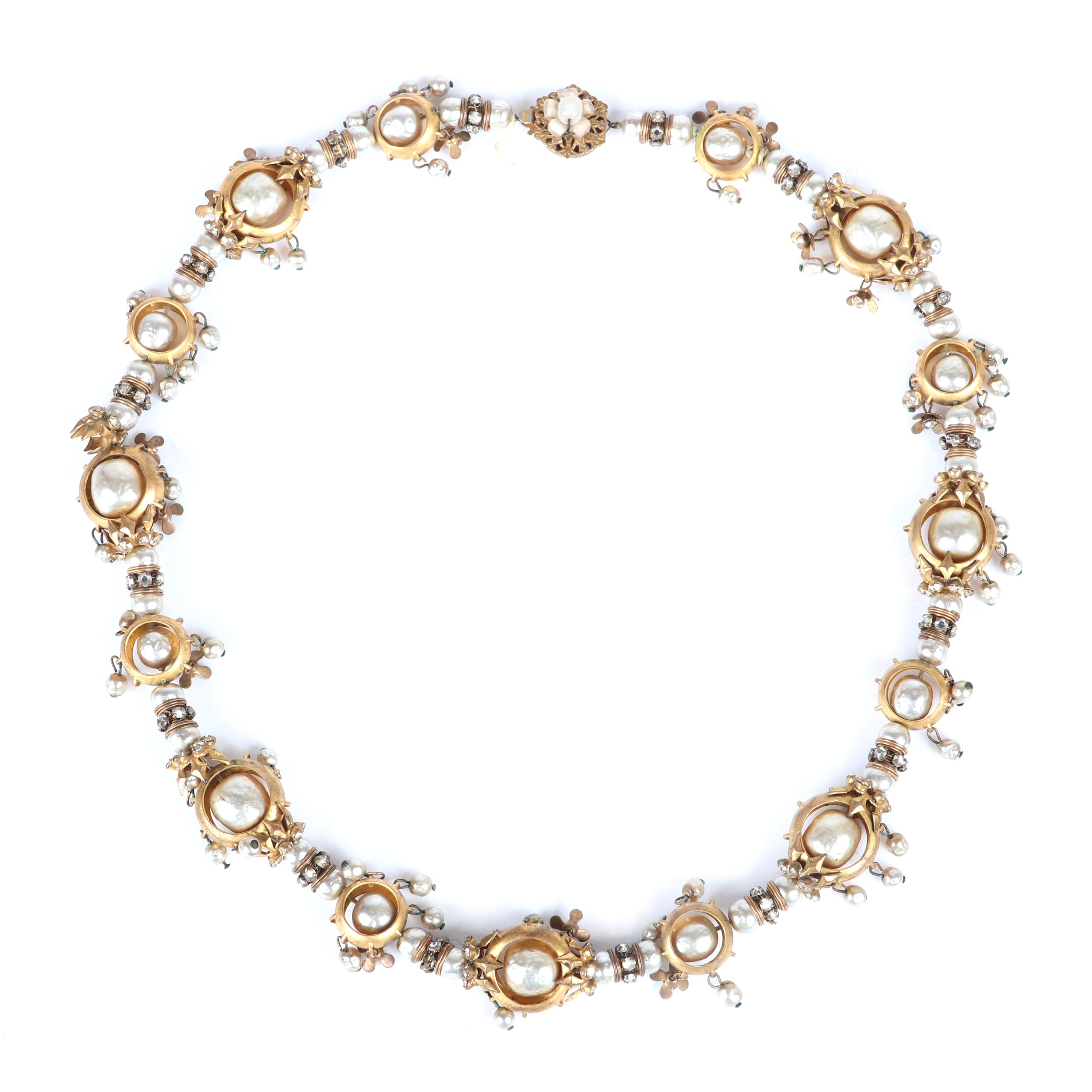 """Miriam Haskell necklace with matte gold tone circular windows framing spinning baroque pearls, with rondelles and dangling small faux pearls. 20""""L"""