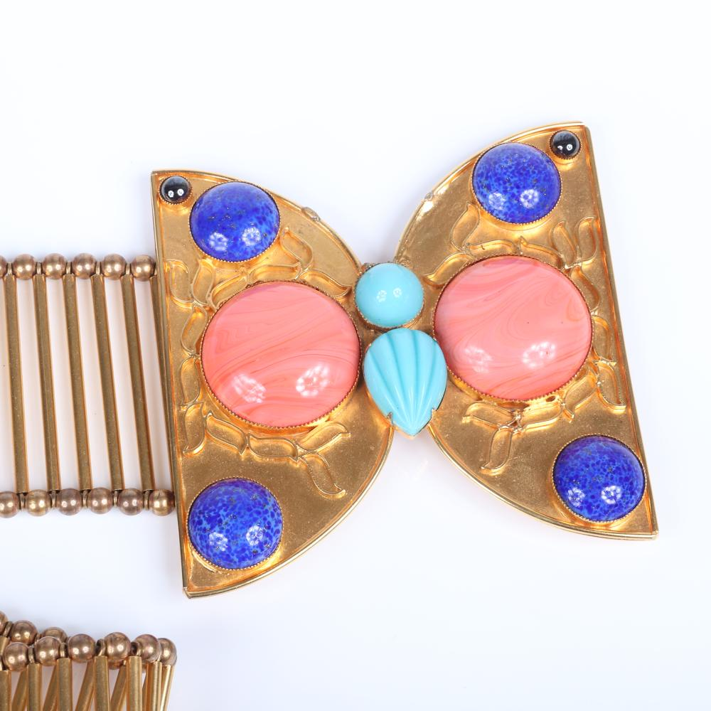 """William DeLillo wide gold tone statement belt with parallel tubular beads, butterfly-shaped buckle with faux pearl, lapis and turquoise cabochon jewels. 32""""L x 2 3/8""""W (belt), 4""""H x 4""""W (buckle)"""