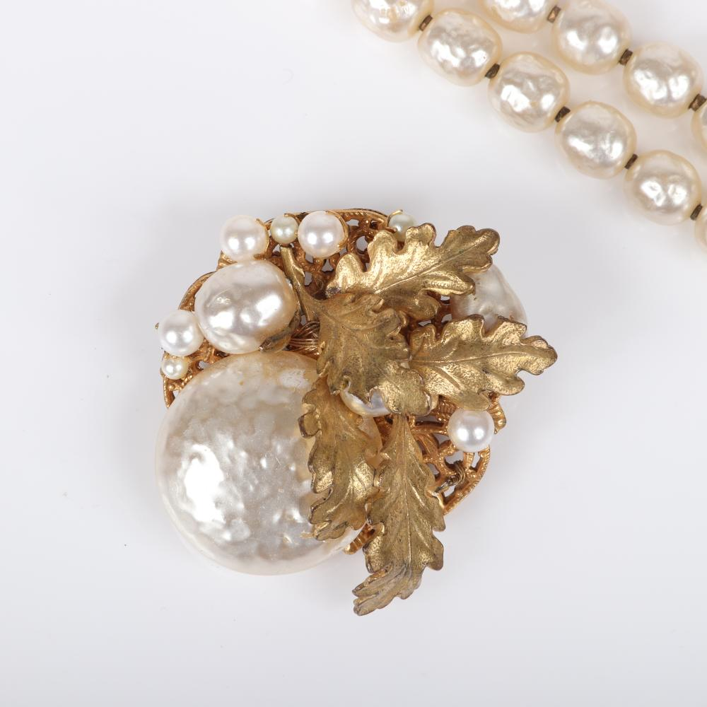Miriam Haskell layered gilt brass oak leaves and Baroque pearl brooch, pave drop earrings with large teardrop faux pearls, and double strand bracelet with floral clasp.