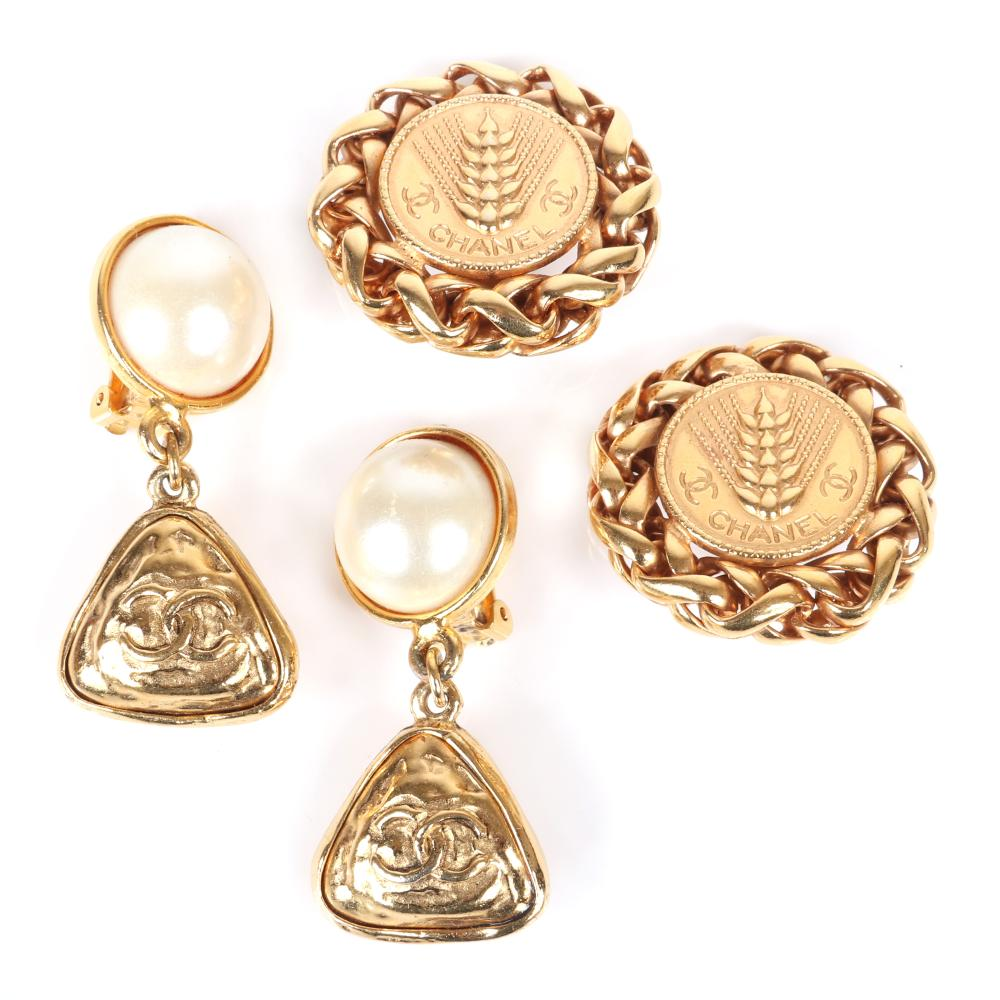 """Two pairs of Chanel designer earrings: gold tone wheat medallion edged in chain and faux pearl with triangular CC logo drop, with original box and felt pouch. 2""""H (pearl), 1 3/4""""diam (wheat)"""